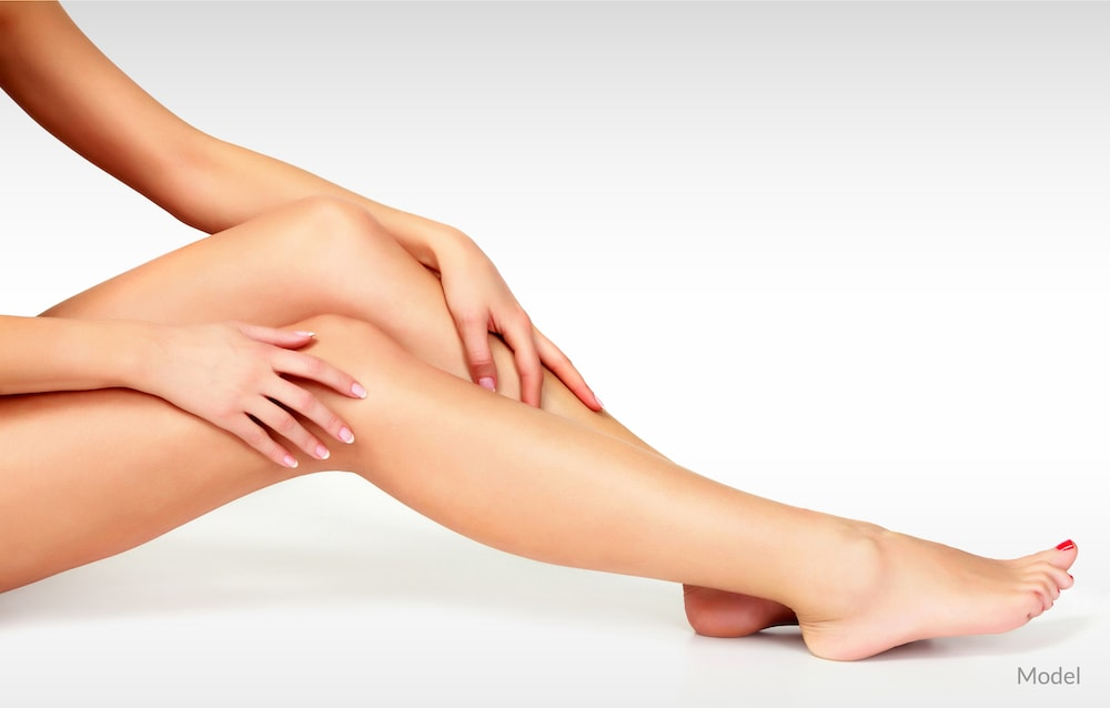 Women touching her legs after a laser hair removal treatment.