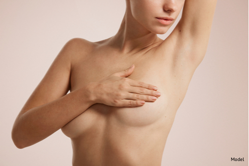 Women covering and lifting her breasts with her arm-img-blog